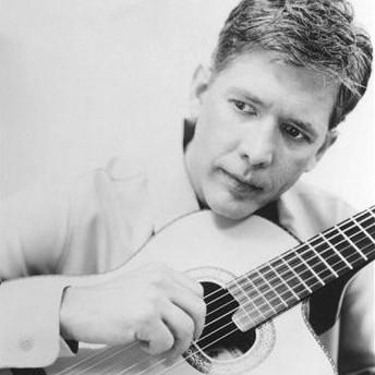 Jack Jezzro playing a guitar